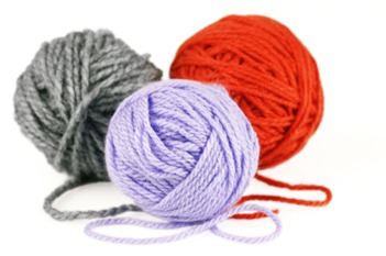 Balls of purple, orange and grey yarn or wool